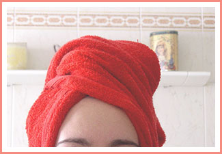 drying-hair-with-red-towel