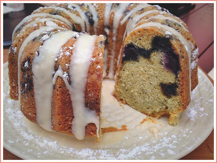 sliced-blueberry-poppy-seed-cake-vanilla-frosting